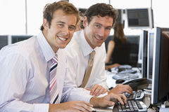 Colleagues Working Together At Computer Stock Photo
