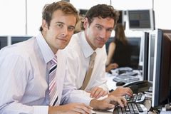 Colleagues Working Together At Computer Stock Photography