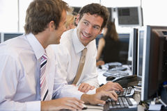 Colleagues Working Together At Computer Stock Photos