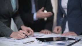 Colleagues working together at office, report presentation, team cooperation. Stock footage stock video