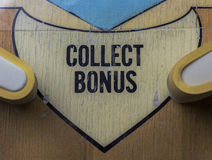 Collect Bonus Logo on a Pinball Machine. Collect Bonus logo on a vintage pinball machine royalty free stock images
