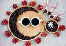 Collect of cafe bean, cup of coffee. Collect of cafe seed, red ripe berries, roasted cofee bean, cup of coffee, wooden spoon ,white flower on bamboo basket stock images