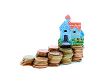 Collect coins for buy a house concept. Collect coins for buy a model house concept stock photography