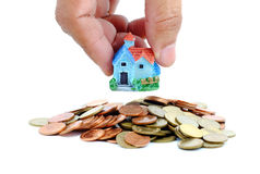 Collect coins for buy a house concept. stock image
