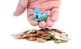Collect coins for buy a house concept. stock photo