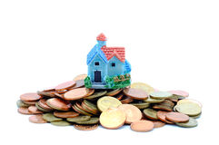 Collect coins for buy a house concept. Collect coins for buy a house concept with white background stock photography