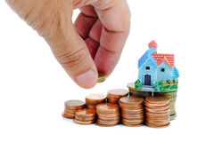 Collect coins for buy a house concept. Collect coins for buy a house concept with white background royalty free stock photos