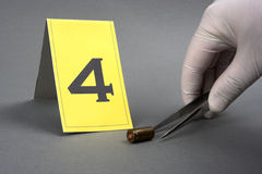 Collect evidence. An investigator collect fired cartridge royalty free stock photos