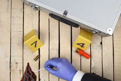 Collect evidence. An investigator collect fired cartridge royalty free stock image