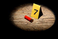Collect evidence. Shotgun shell marked as evidence in a spot light royalty free stock photos