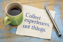 Collect experiences not things. Words of inspiration on a napkin with a cup of coffee royalty free stock image