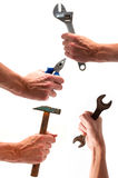 Collect of four hands with various equipment royalty free stock photography