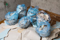 Collect garbage in the garbage bag, Royalty Free Stock Images