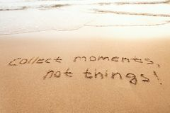 Collect moments, not things - happiness concept. Happy lifestyle inspirational quote, enjoy the life, text on sand stock images