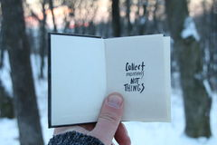 Collect moments not things. Travel idea. Book with the inscription. Collect moments not things. Hand holding a book with the inscription stock images