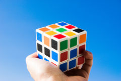 Collect parts of fate. A colorful cube of a rubik in the hands of a man stock photos
