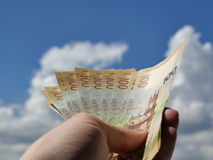 Collectable banknotes with the image of the Crimea on the background of blue sky with clouds. Collectible one hundred rubles banknote with the image of the Royalty Free Stock Photo