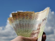 Collectable banknotes with the image of the Crimea on the background of blue sky with clouds Royalty Free Stock Image