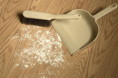 Collected dust with pan background. Cleaning dust on the wooden flooring Royalty Free Stock Photos
