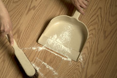 Collected dust with pan Royalty Free Stock Photography