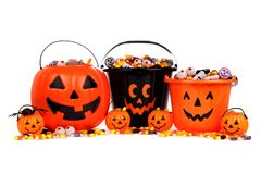 Collecteurs de sucrerie de lanterne de Halloween Jack o d'isolement sur le blanc photos stock