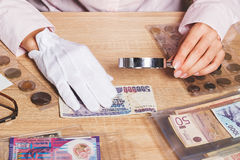 Collectible banknotes in the woman`s hand. Collectible banknotes in the plastic pocket in the woman`s hand, soft focus background Stock Photos