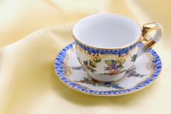 Collectible cup for mother's day. Collectible cup on yellow satin background Stock Photography