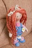 Collectible doll handmade with red natural hair Stock Photo