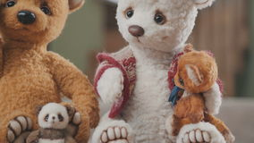 Collectible soft toy - a teddy bear, as in the 20th century. Craft stock video