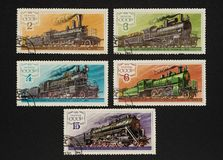 Collectible stamps from USSR, set of locomotives and trains. Collectible stamps from USSR Soviet Union, issued in 1979. Set of locomotives and trains Royalty Free Stock Photo