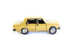 Collectible toy model car. Collectible toy model beige Soviet car VAZ-2105 (LADA Stock Photos