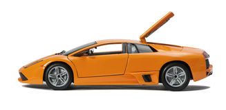 Collectible toy sport car model. With an open hood on white background Stock Photo