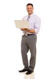 Collectieve laptop van de arbeidersholding Stock Foto's