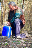 Collecting birch sap Stock Photography