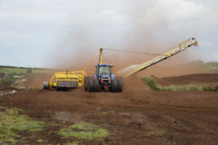 Collecting bog. Heavy machinery collecting bog in Ireland royalty free stock photography