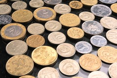 Collecting coins. Collection of coins laid out on a table Royalty Free Stock Photography
