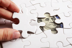 Collecting dollar banknote with jigsaw puzzle Royalty Free Stock Image