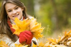 Collecting falling leaves Stock Images