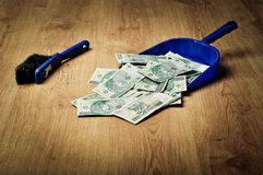 Collecting money from the floor Royalty Free Stock Photo