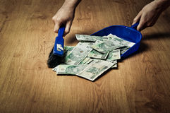 Collecting money from the floor Stock Images
