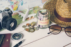 Collecting money for travel with accessories of traveler Stock Photo