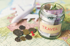 Collecting money for travel Royalty Free Stock Image