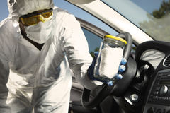 Collecting of odor traces by criminologist from car Royalty Free Stock Photo