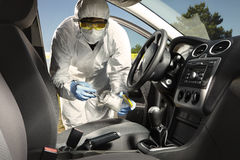 Collecting of odor traces by criminologist from car Stock Images
