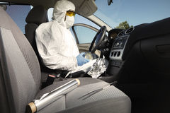 Collecting of odor traces by criminologist from car Stock Photos