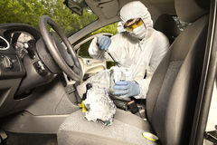 Collecting of odor traces by criminologist from car keys Stock Images