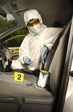Collecting of odor traces by criminologist from car keys Stock Photography