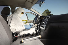 Collecting of odor traces by criminologist from drive wheel Stock Photography