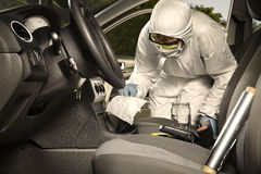 Collecting of odor traces by criminologist from gear shift Royalty Free Stock Photography