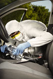Collecting of odor traces by criminologist from gear shift Stock Photo
